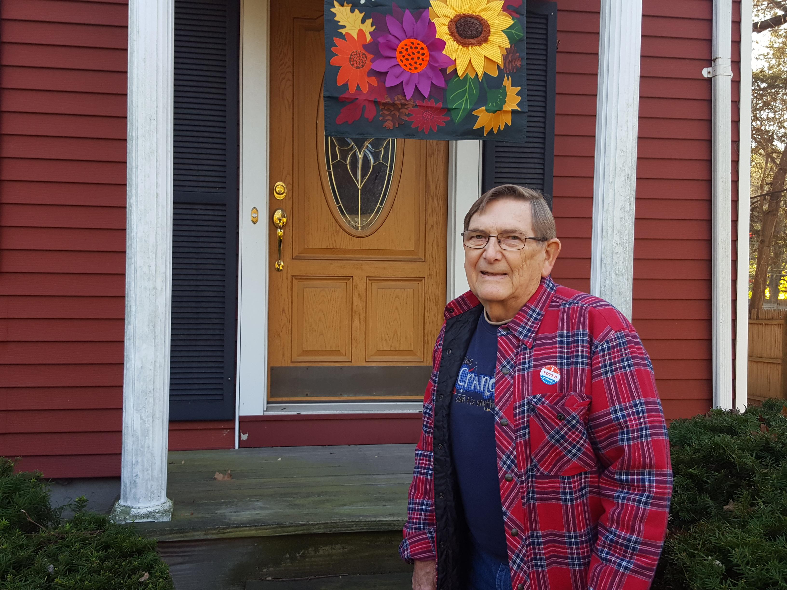 Bill in front of his front door.