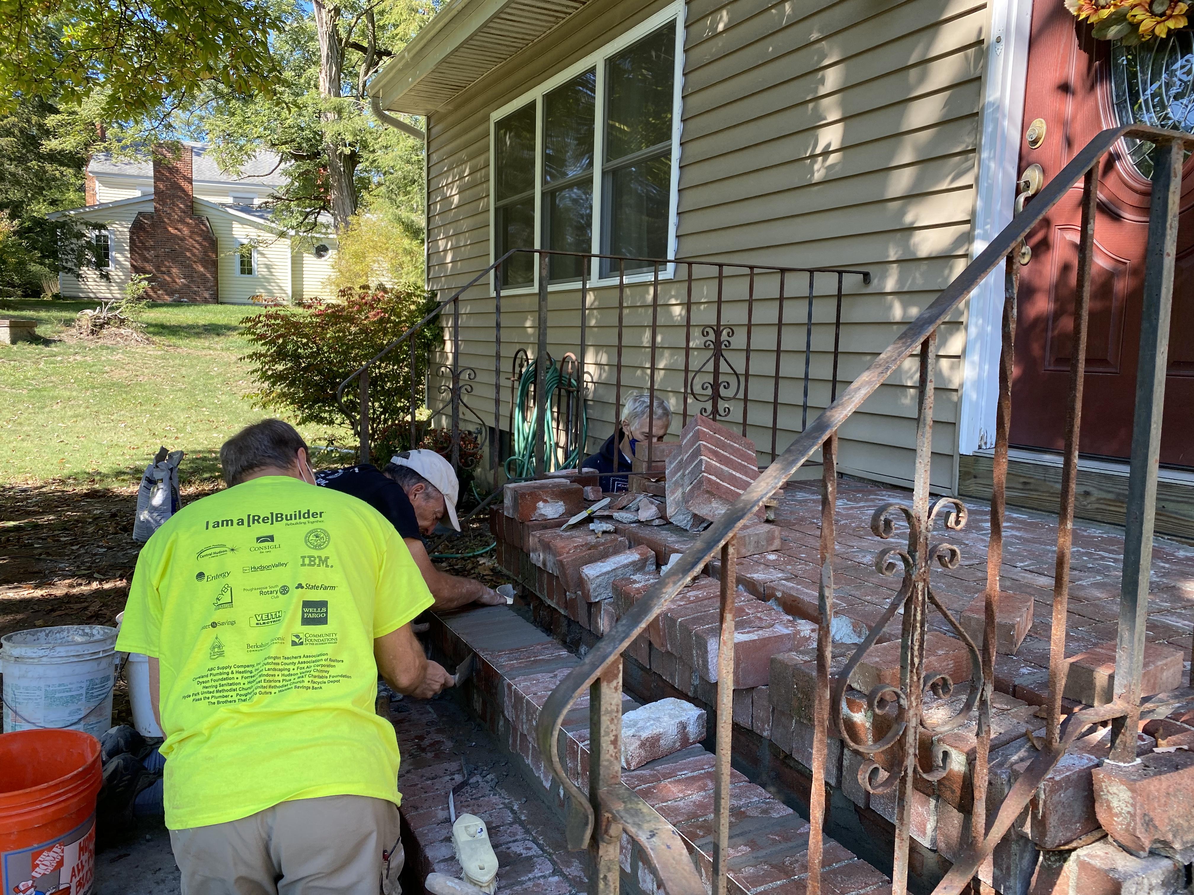 UMCHP volunteers repairing the front steps