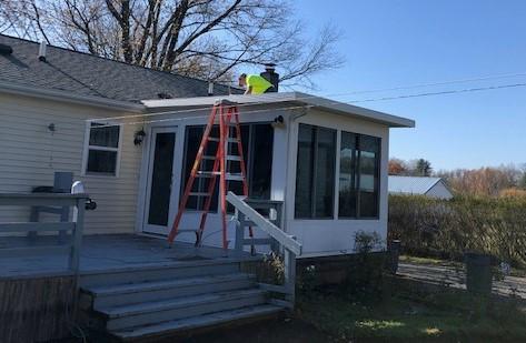 A Consigli volunteer repairing the sunroom roof