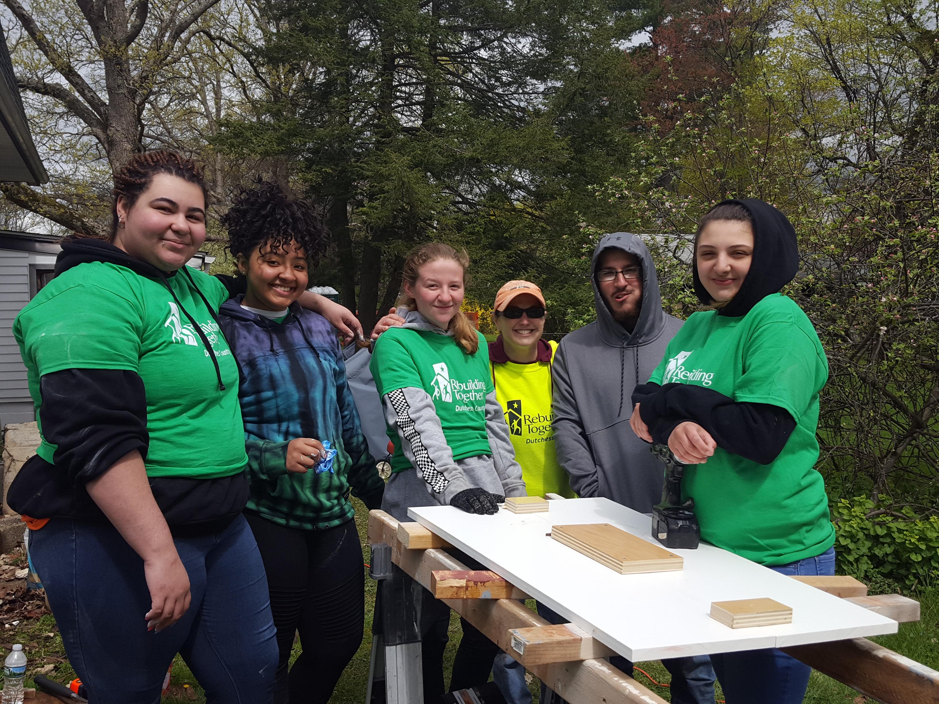 Volunteer Coordinator, Laura, with volunteer high school students.