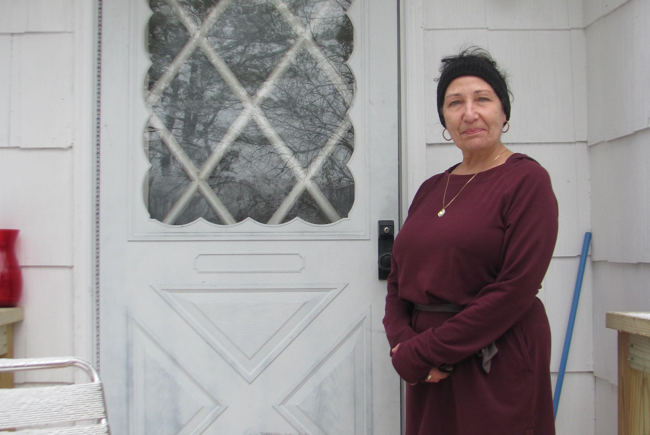 Homeowner Michele in front of her front door.