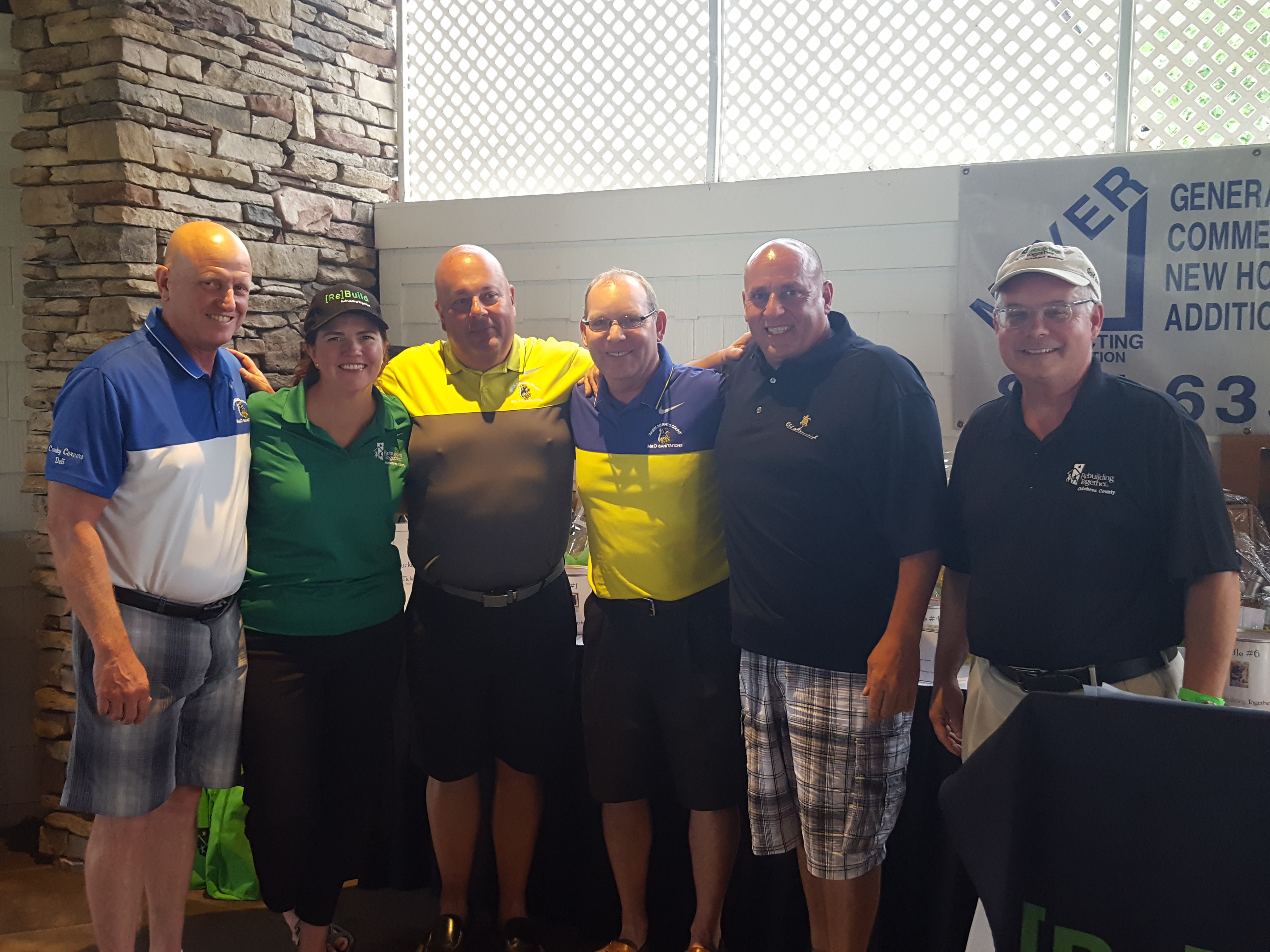 Fran Pomarico, Executive Manager of Poughkeepsie Nissan, with his winning foursome and RTDC ED Christina Boryk and Golf Committee Chair Bill Francis.