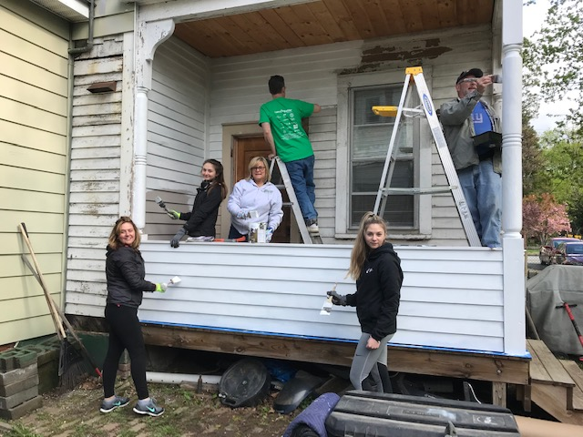Volunteers paint the back porch of a Dutchess County resident this past April, thanks to Rebuilding Together's Rebuilding Day program.