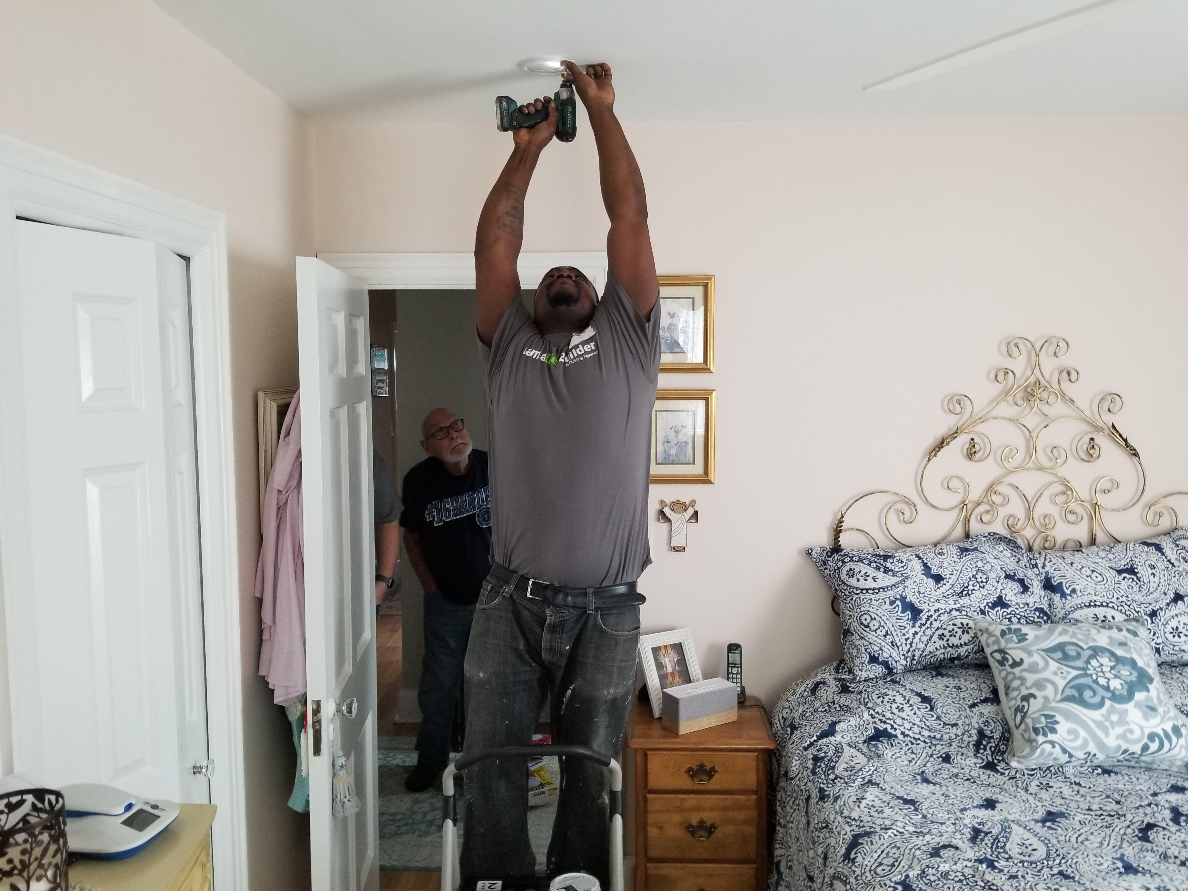 A State Farm volunteer installs a smoke alarm