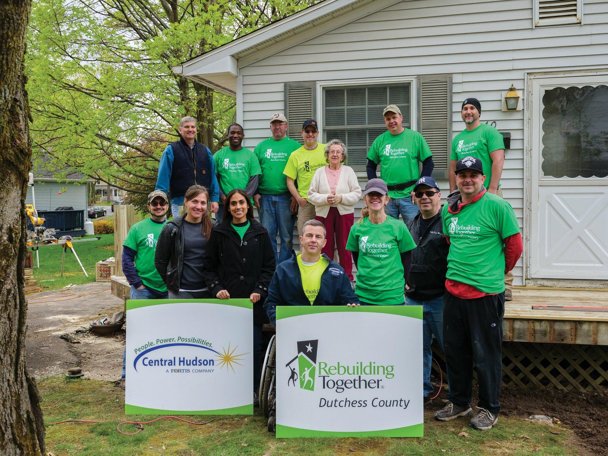 Central Hudson volunteers serving a Red Hook homeowner.