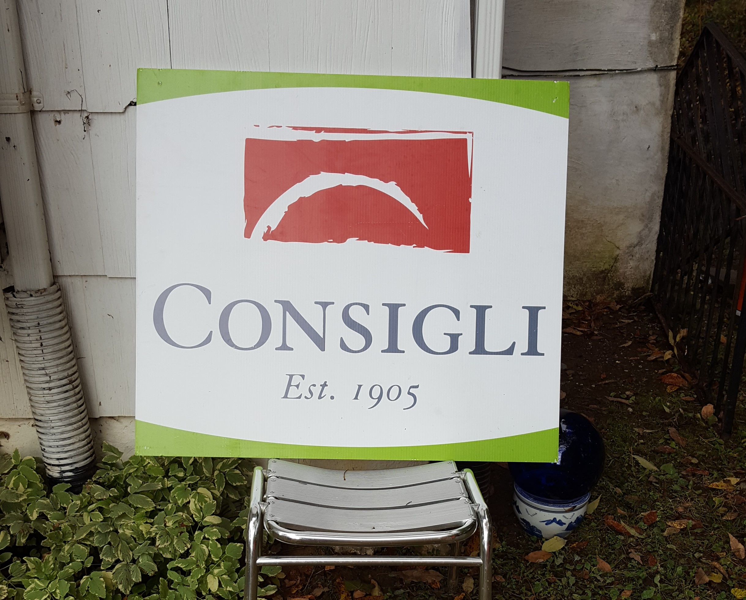 Consigli sign at a project site.
