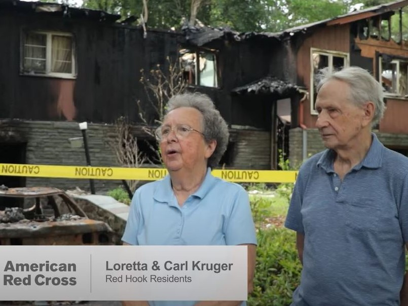 Carl and Loretta Kruger in front of their burnt home