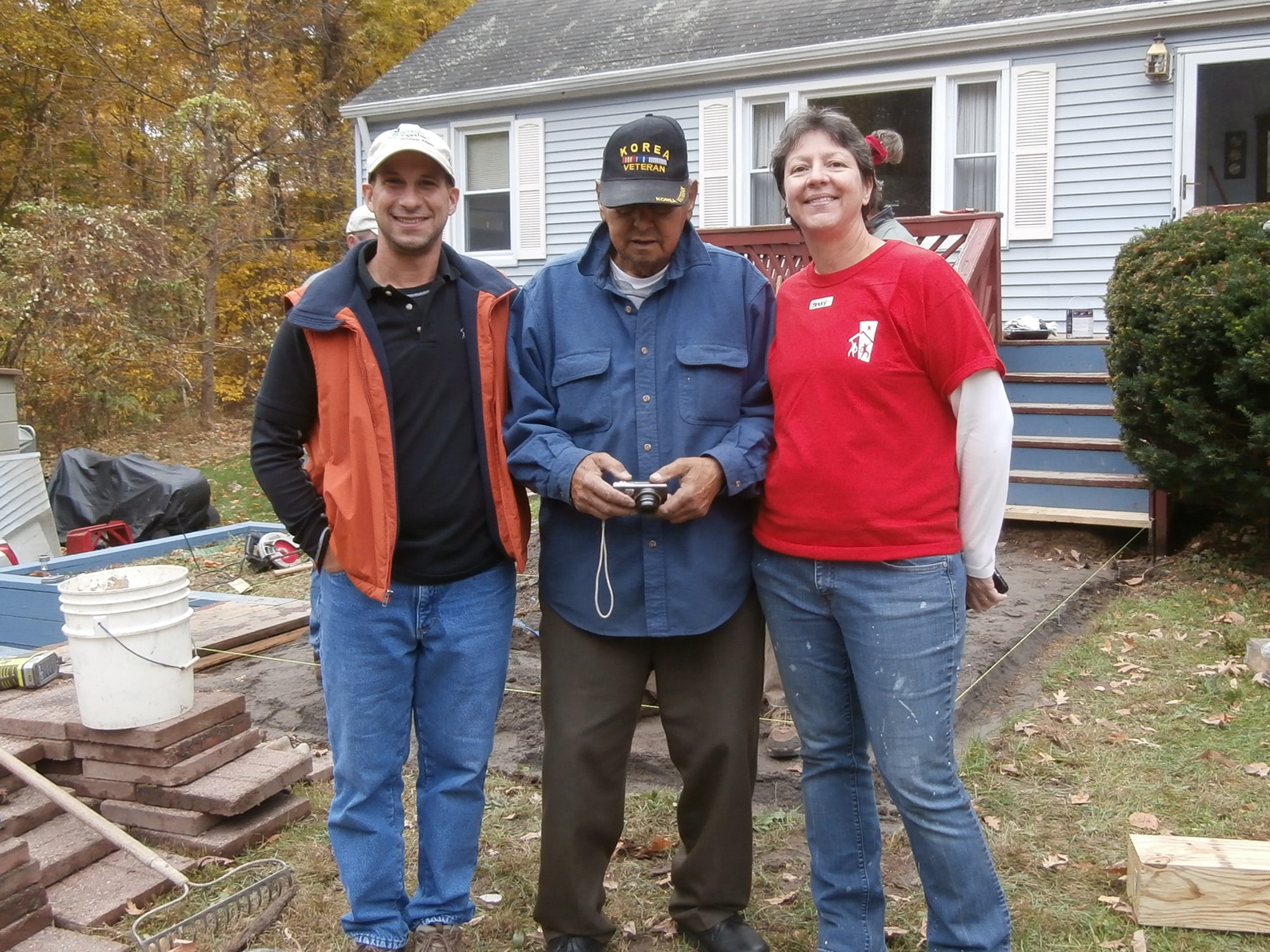 Wyeth with a homeowner and volunteer coordinator Terry Temple.